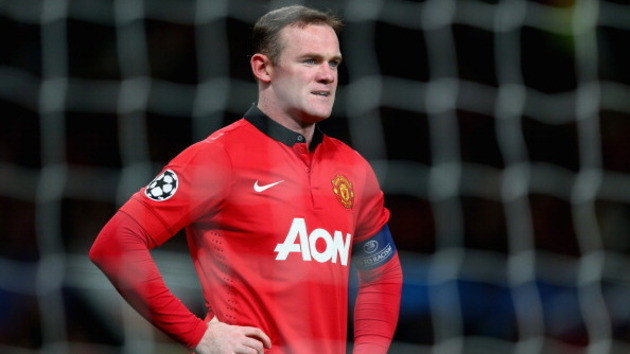 454921149-wayne-rooney-of-manchester-united-looks-on-during-the