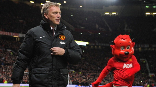 459977295-manchester-united-manager-david-moyes-walks-with-mascot