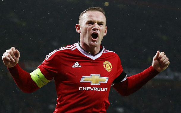 Wayne Rooney, diz que quer imitar Paul Scholes em um novo papel no meio-campo do Manchester United.